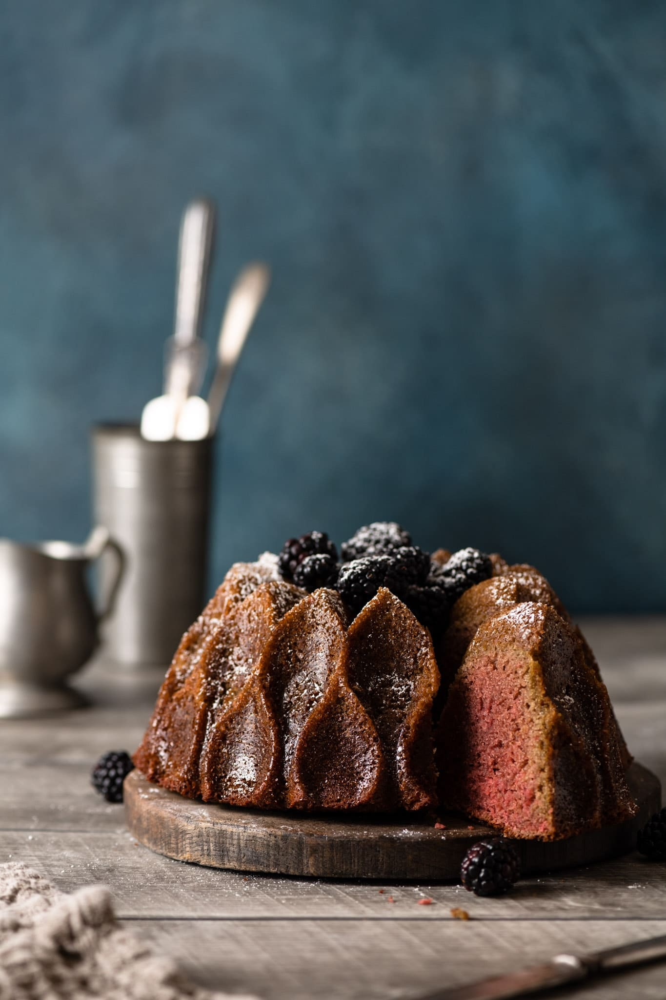 Homemade blackberry wine cake sliced with powdered sugar.