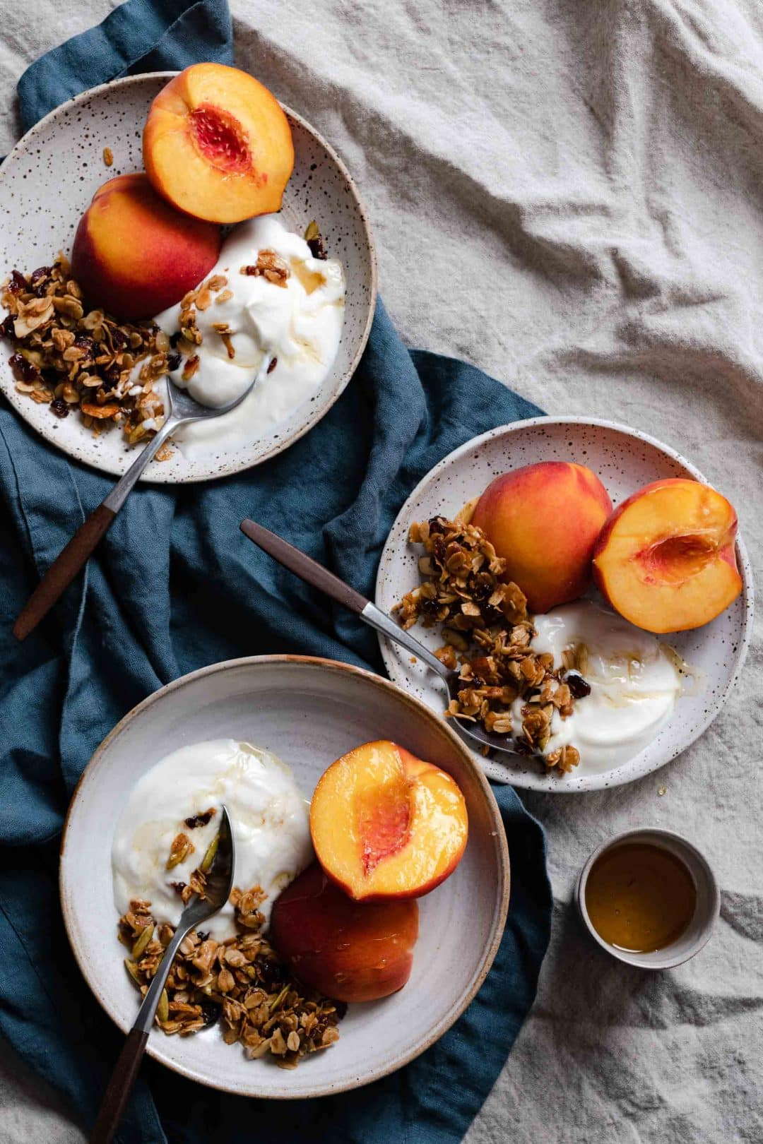 Granola and yogurt with fresh peaches