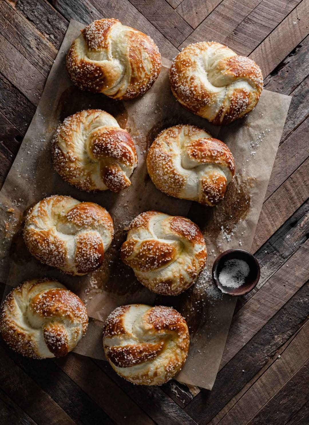Salted pretzel knots on table in a row.