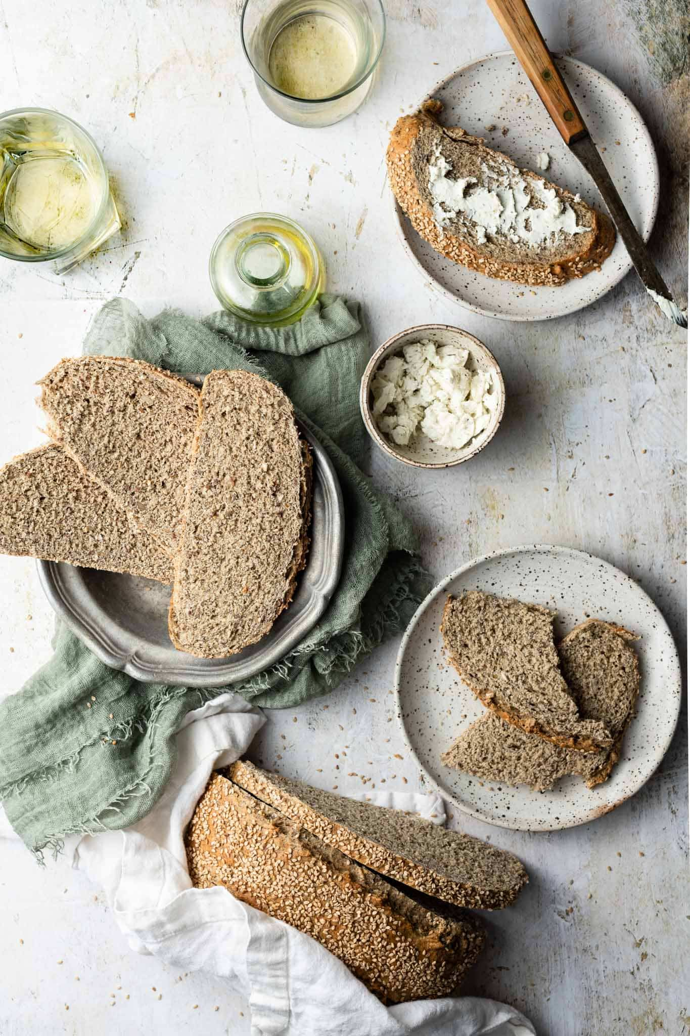 Easy Multigrain Bread served with herb goat cheese and wine.