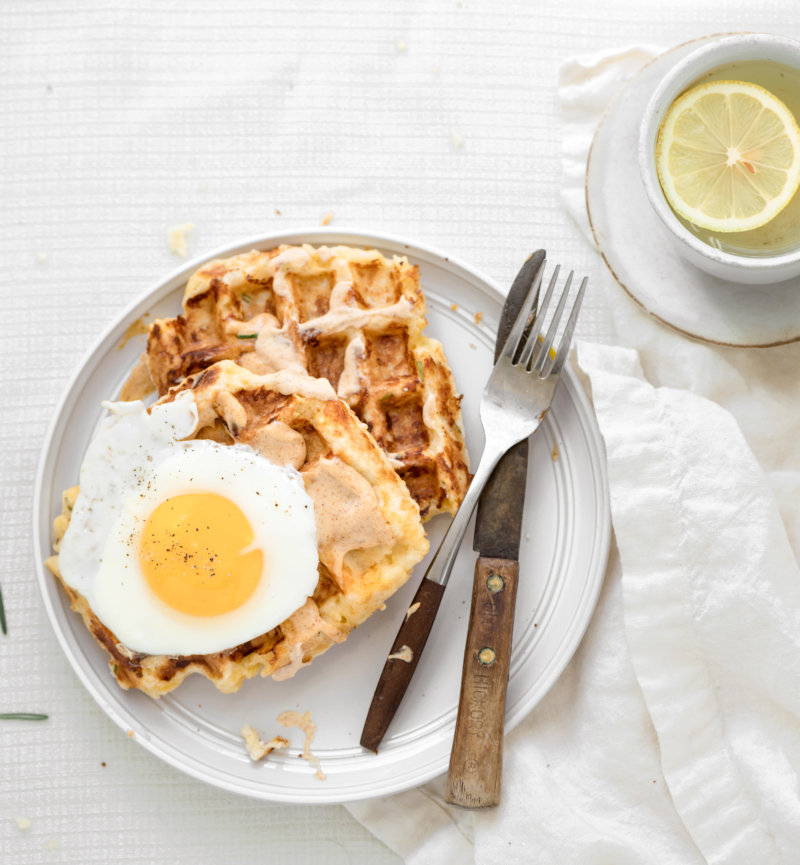 egg on rosemary waffles