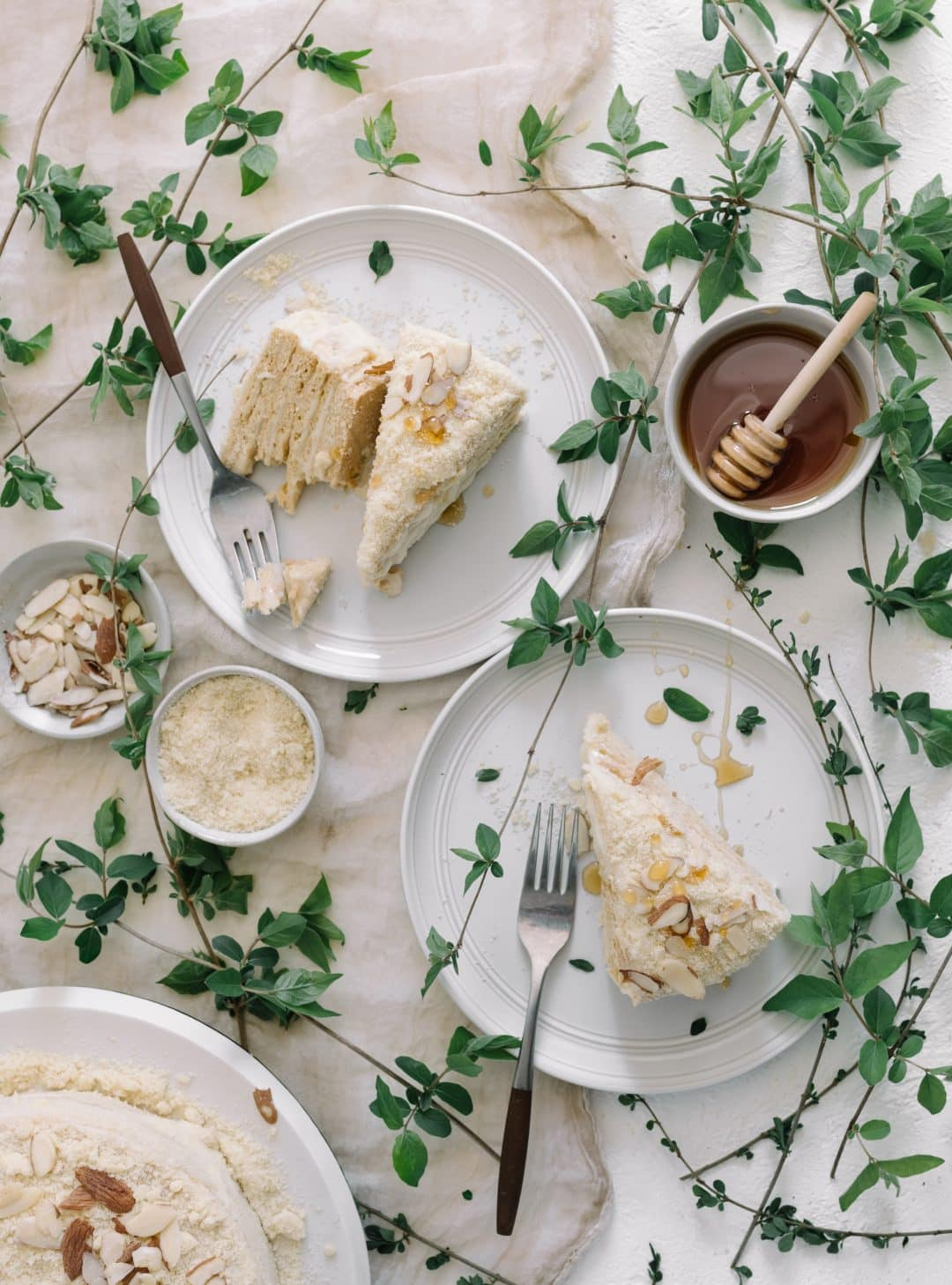 russian honey cake slices on table with honeysuckle vine