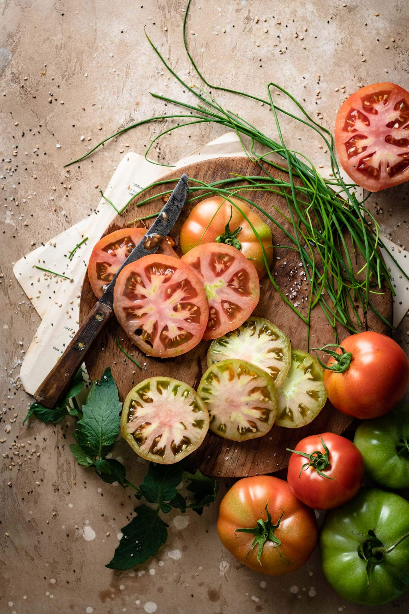 Sliced heirloom tomatoes and chives.