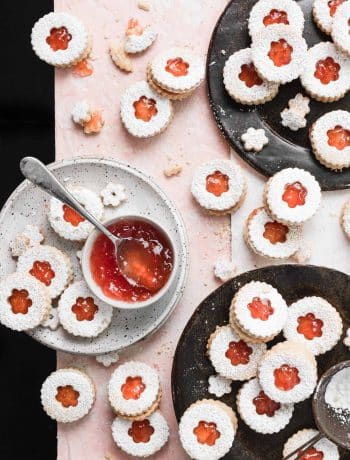 grapefruit almond linzer cookies on plates