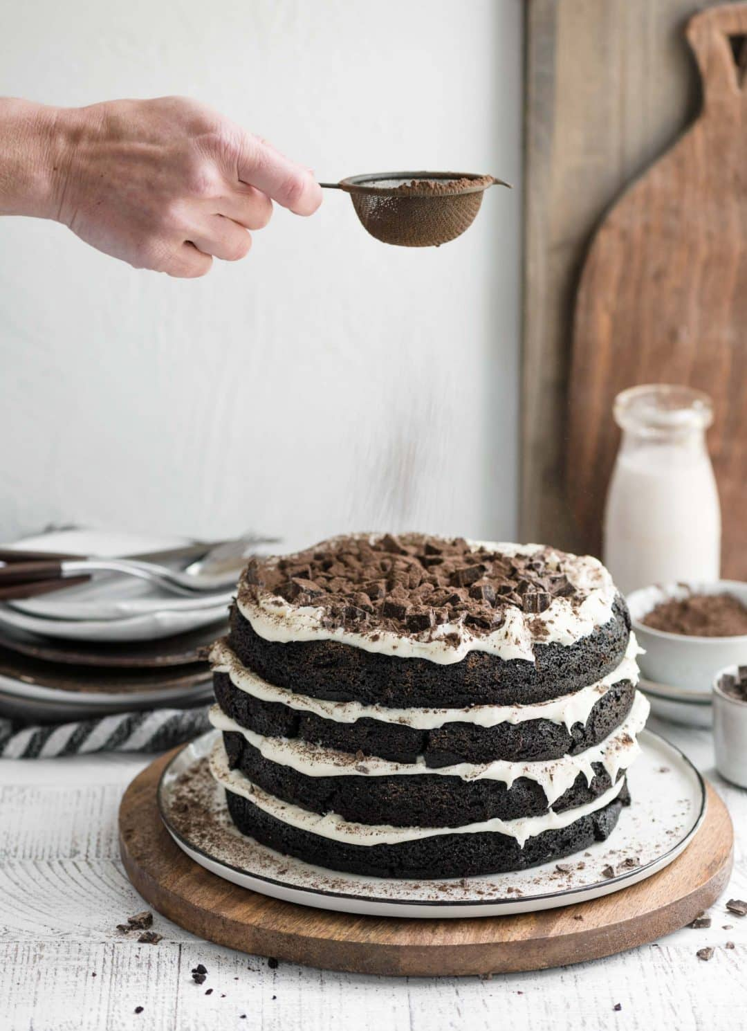 mocha latte cake with a dusting of chocolate powder