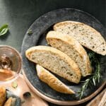 Sliced of herb bread on silver plate.
