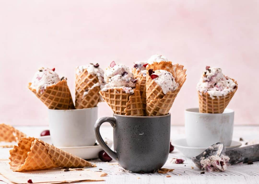 chocolate cherry ice cream in waffle cones