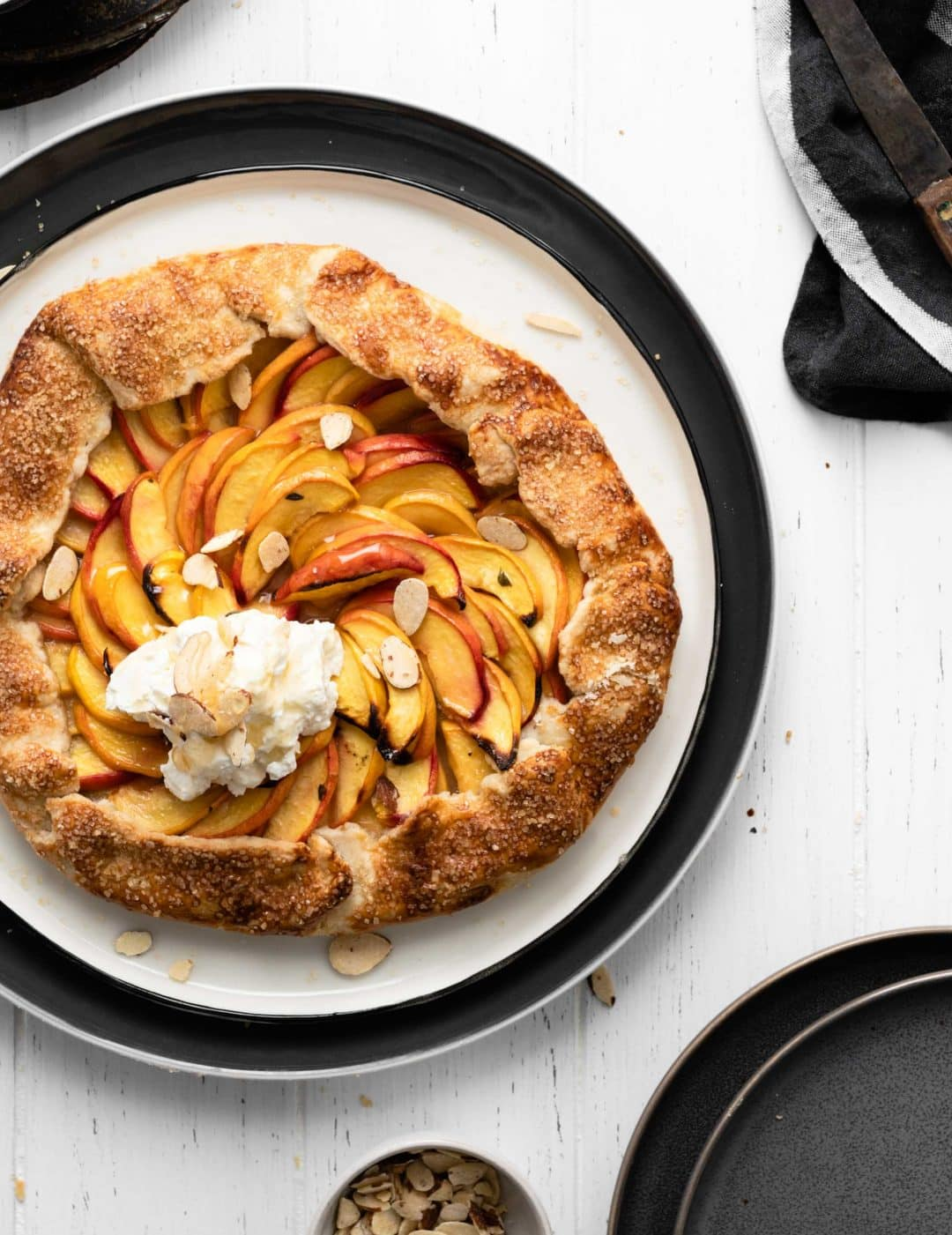 baked lemon thyme peach galette with cream and almonds
