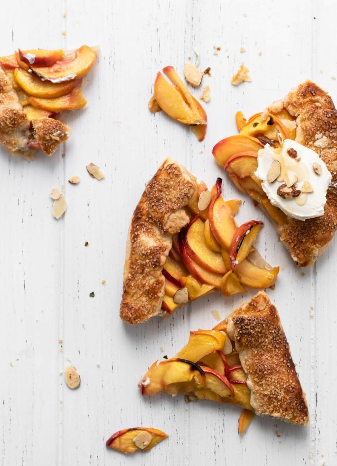 slices of peach galette with cream