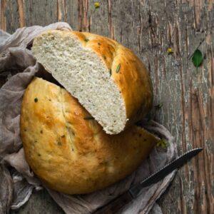 rustic tuscan herb bread sliced in half