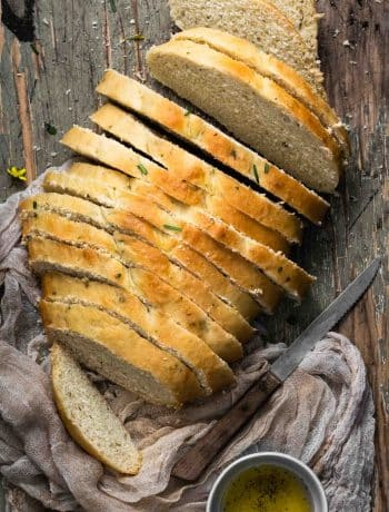 slices of tuscan herb bread served with olive oil