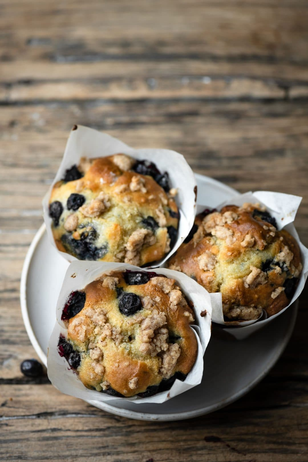 Homemade coffee muffins filled with fresh blueberries.