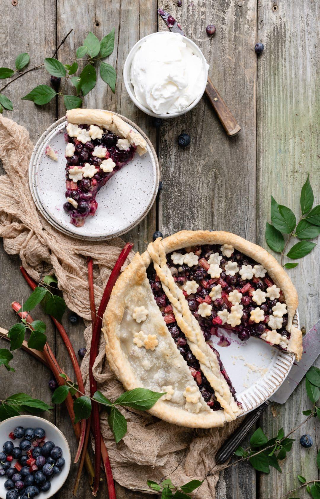 Sliced Blueberry Rhubarb Pie with flower crust design