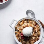 Baked Cherry Crisp with a scoop of vanilla ice cream