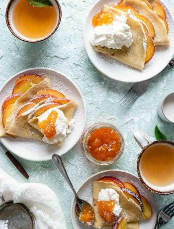 Peach Crepes topped with cream and peach preserves