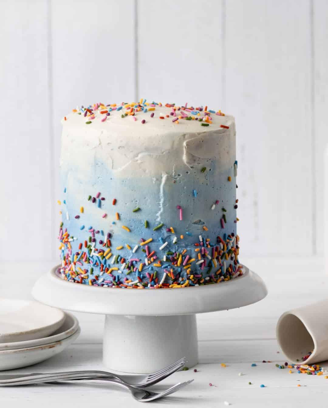 blue ombre layered almond birthday cake