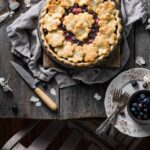 Homemade Blueberry Rhubarb Pie with honey.
