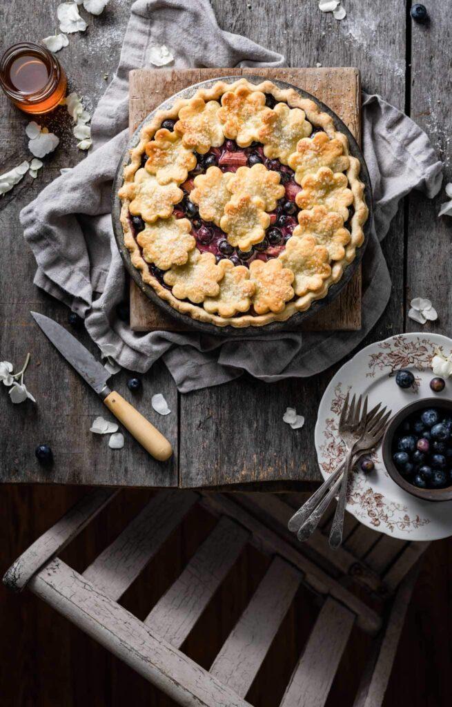 Homemade Blueberry Rhubarb Pie with honey.