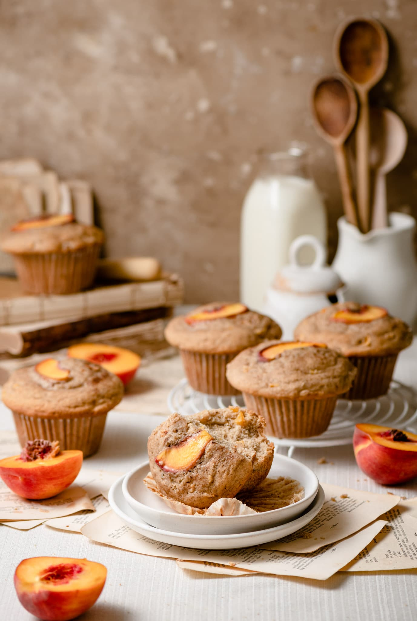 Breakfast muffins topped with peach slices.
