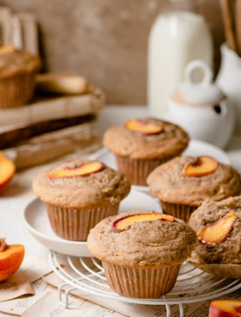 Peach Breakfast Muffins with large muffin tops.