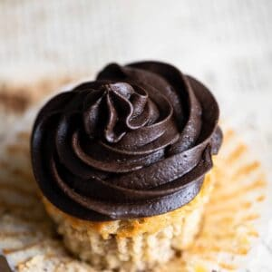 Closeup of a chocolate frosted cupcake.
