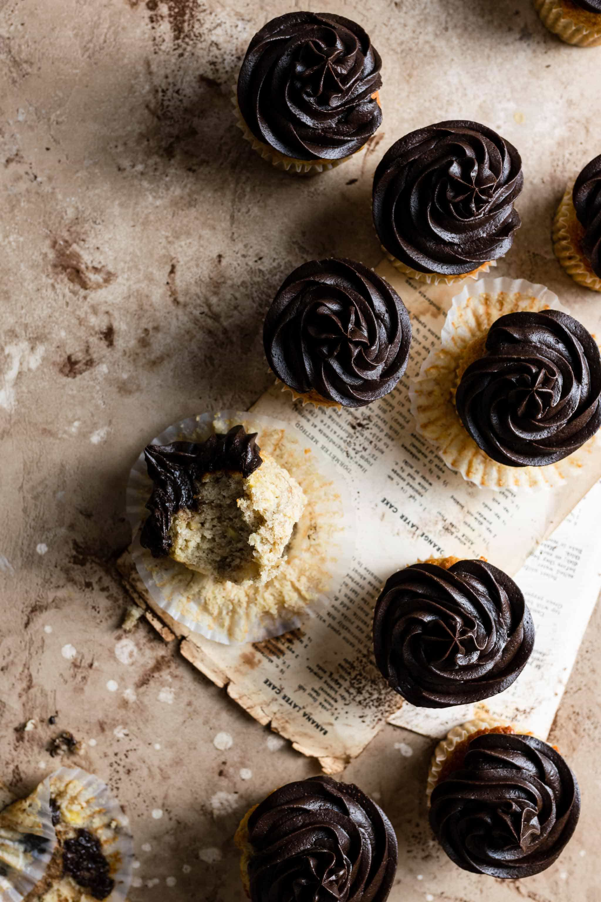 Cupcakes on a table with recipe pages.