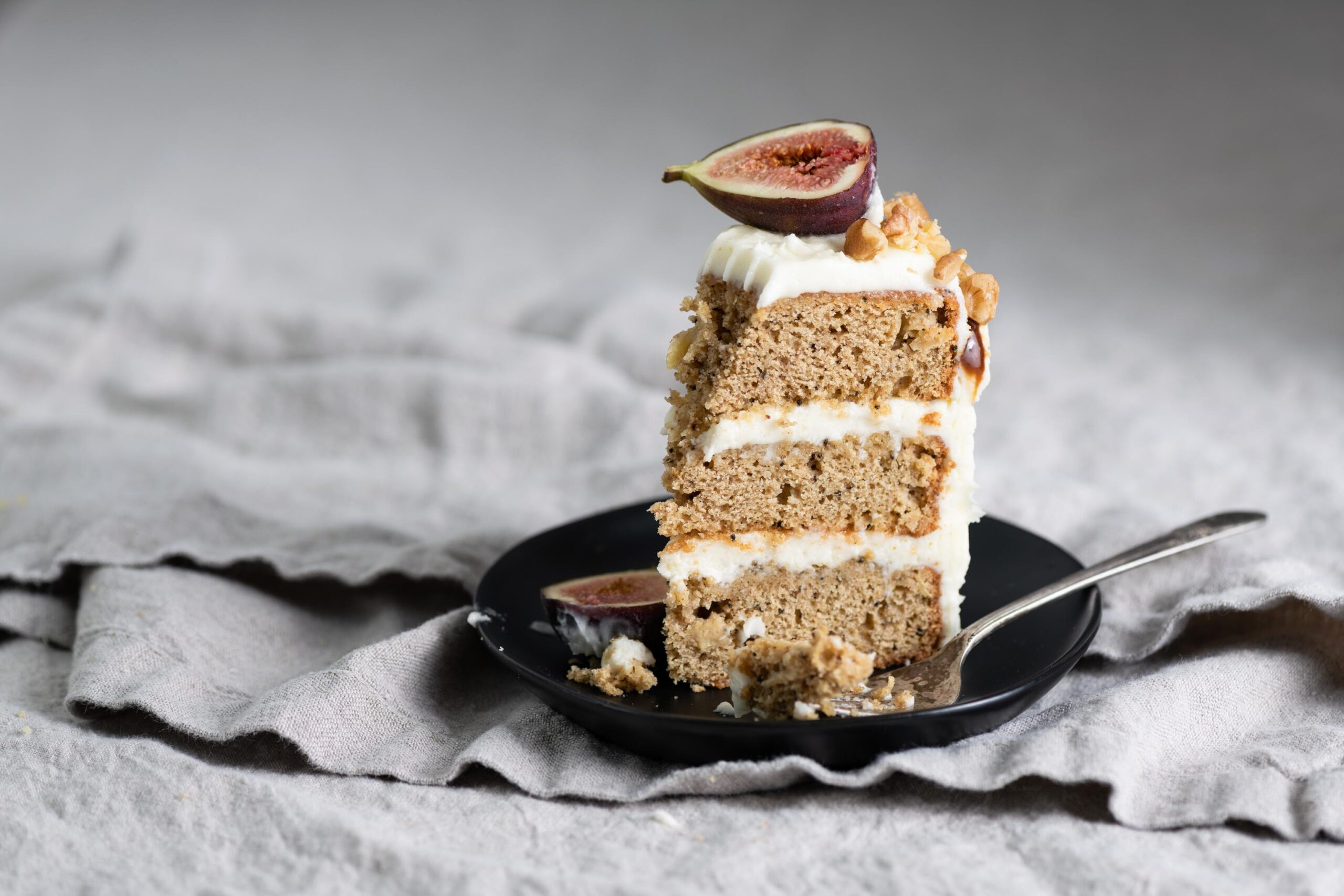 Slice of layered Apple Cake with Maple Cream Cheese Frosting