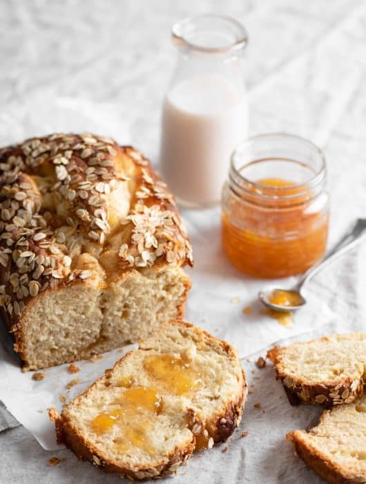 Brioche Bread Loaf made with peach preserves and served with milk