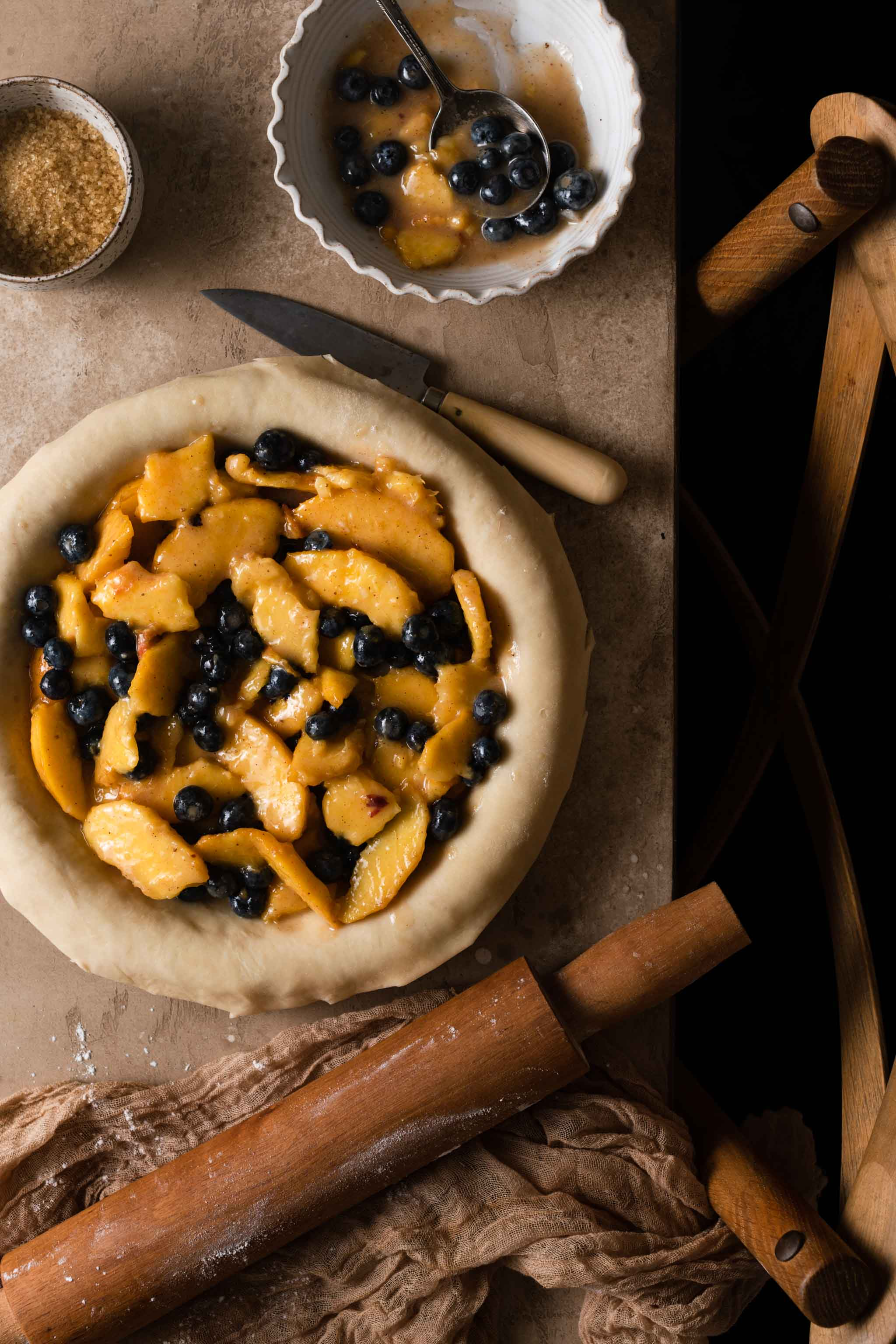 Peach and Blueberry Pie filling in a pie crust
