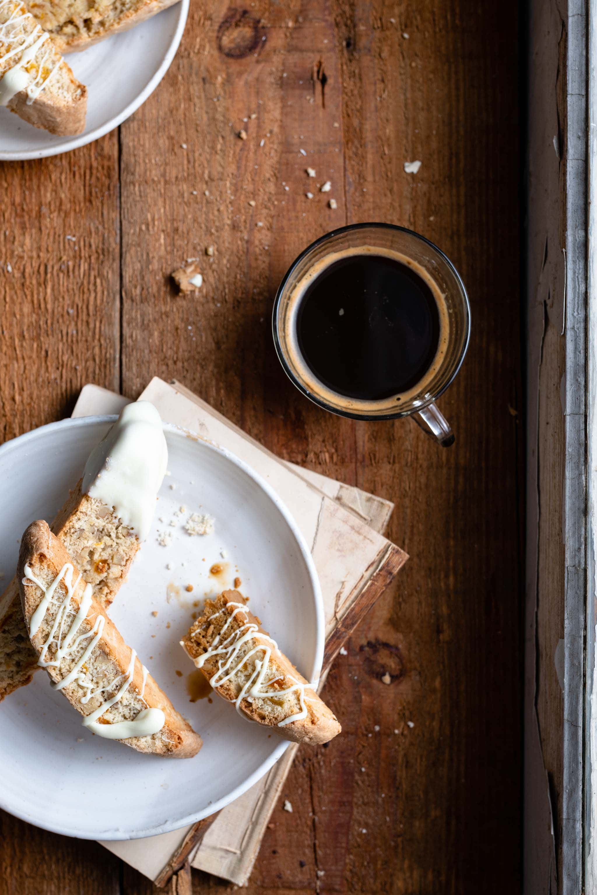 apricot walnut biscotti with white chocolate drizzle and coffee