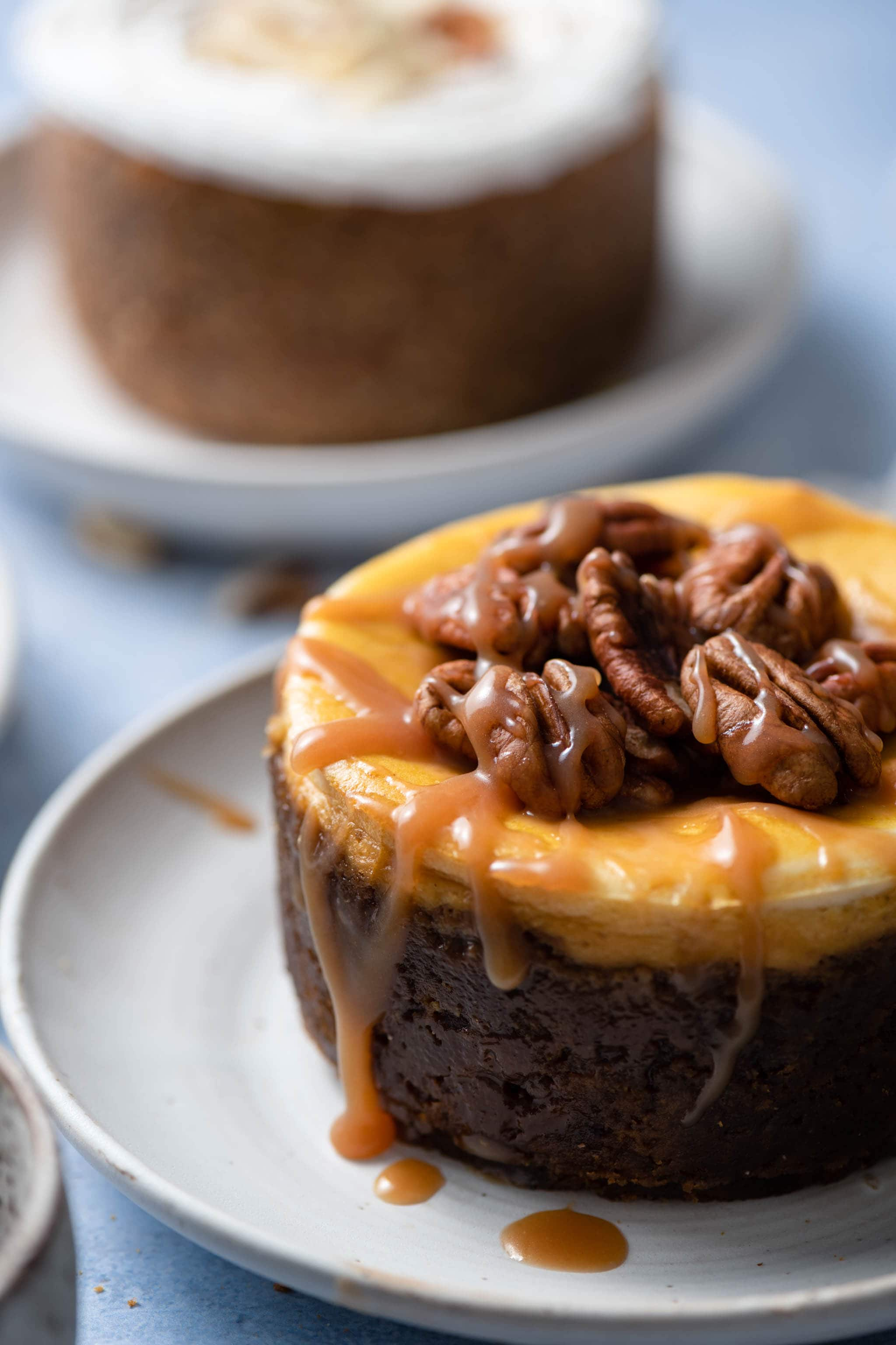 Pumpkin Cheesecake with Gingersnap Cookie Crust topped with pecans and caramel