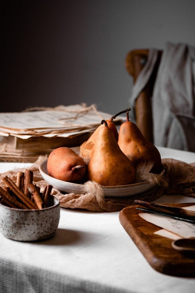 Pears in a bowl on a table.