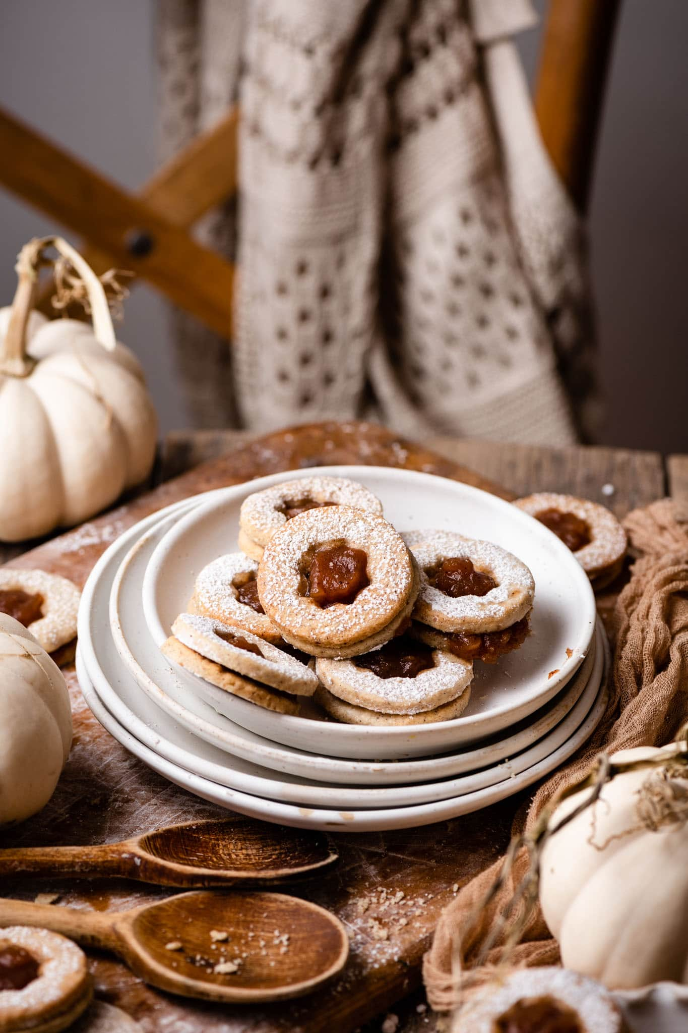 Linzer cookies made with pumpkin spice and apple butter