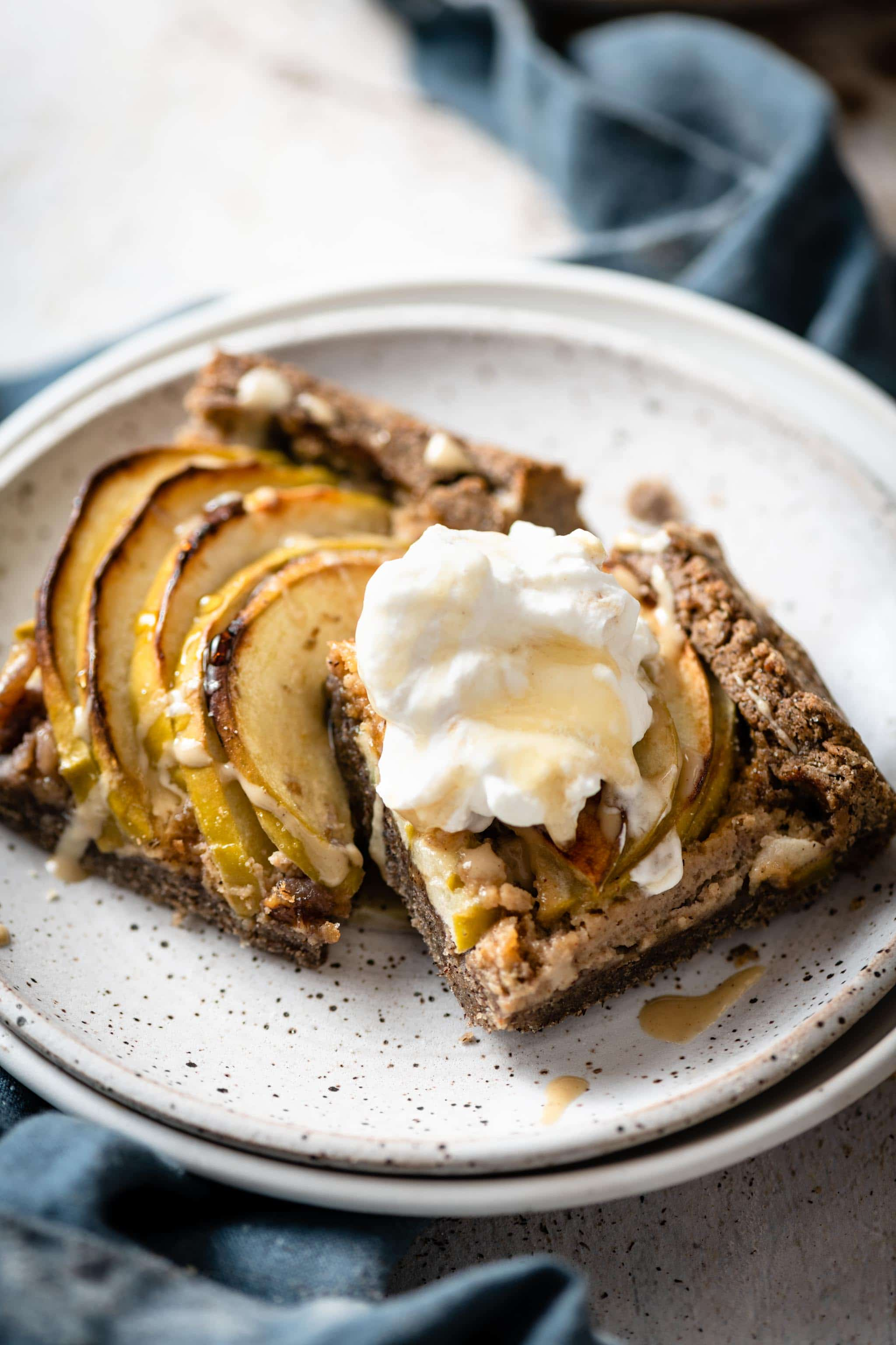 pear apple galette topped with tahini and whipped cream