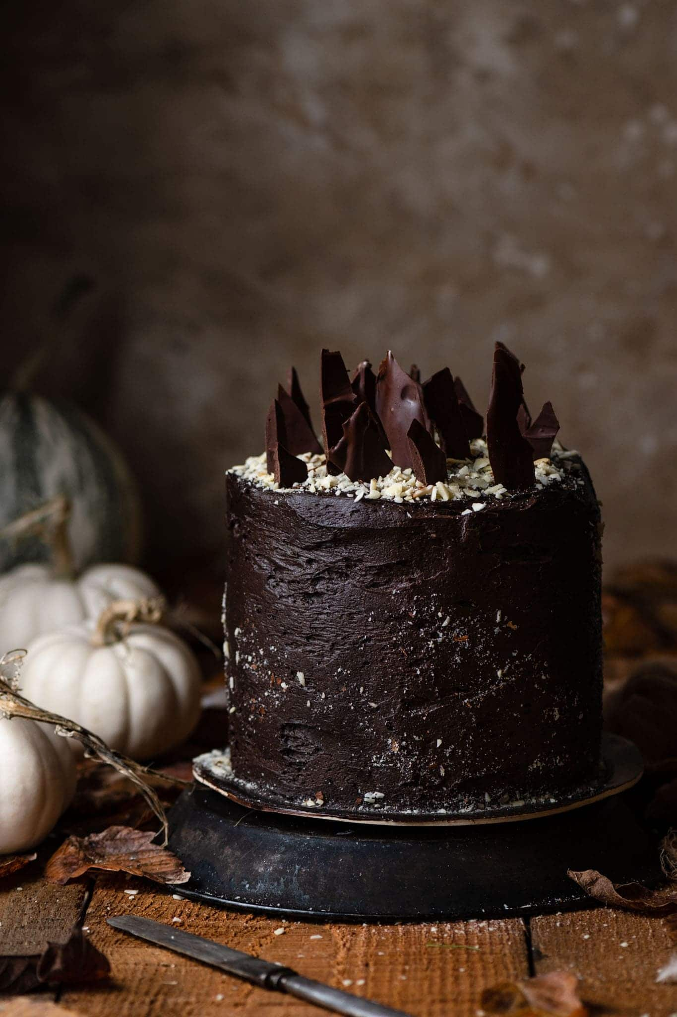 Halloween Cake with chocolate buttercream, hazelnut flour, and chocolate shards