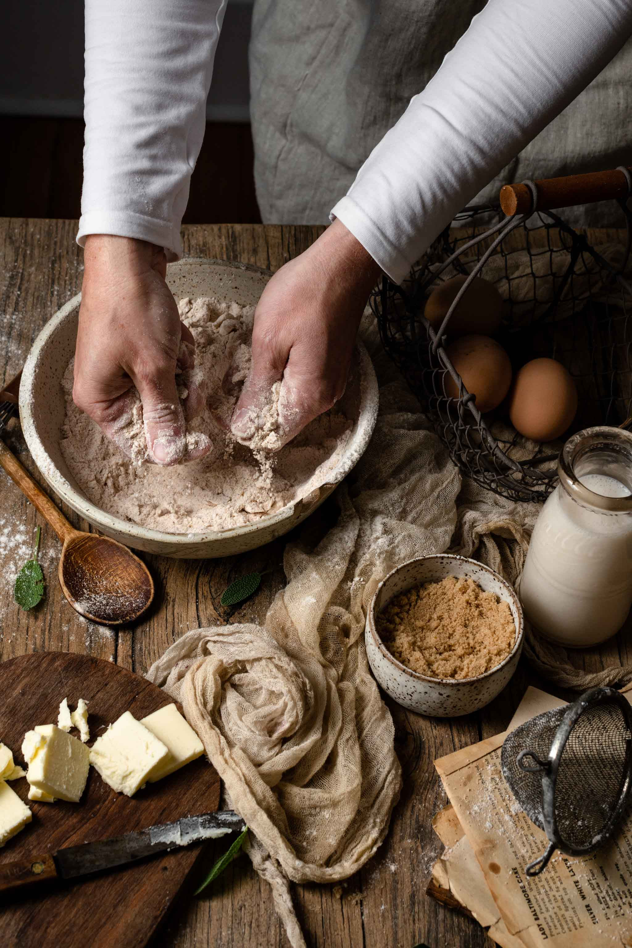 Food photography of baker mixer butter and flour together with hands