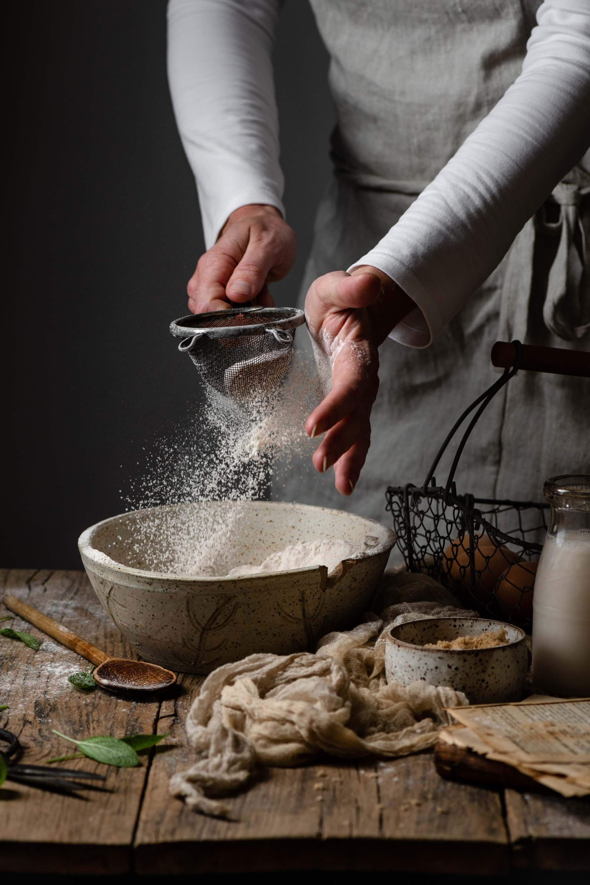 Food Photography of baker sifting flour
