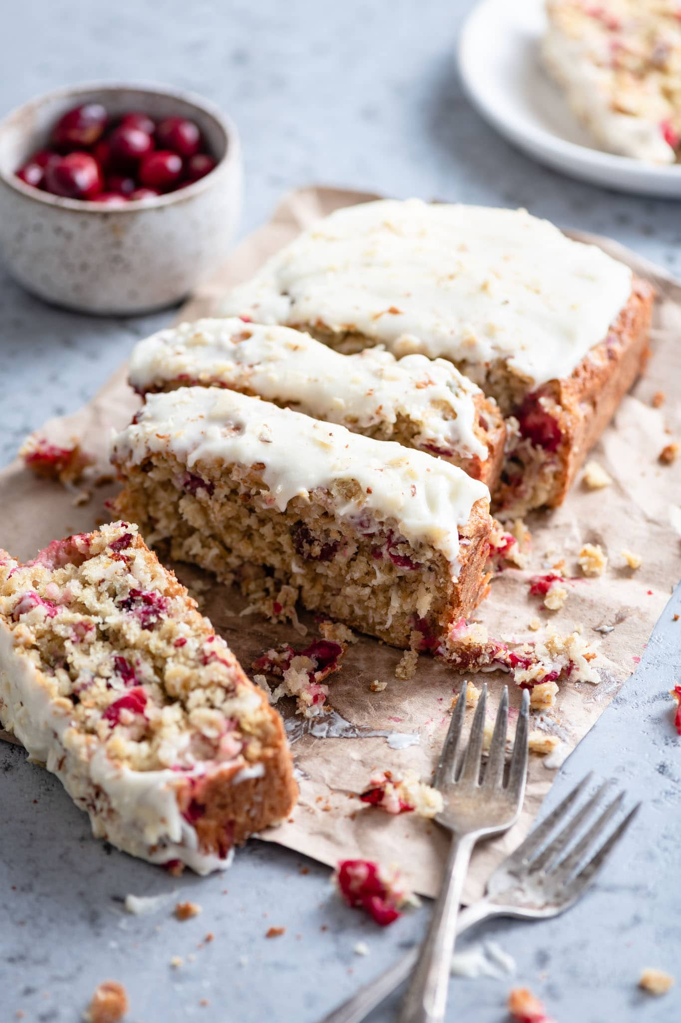 moist coconut cranberry bread with honey cream cheese frosting