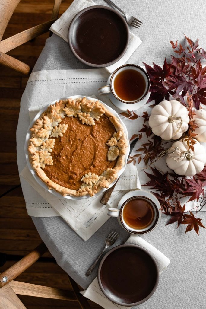 Thanksgiving table with homemade sweet potato pie