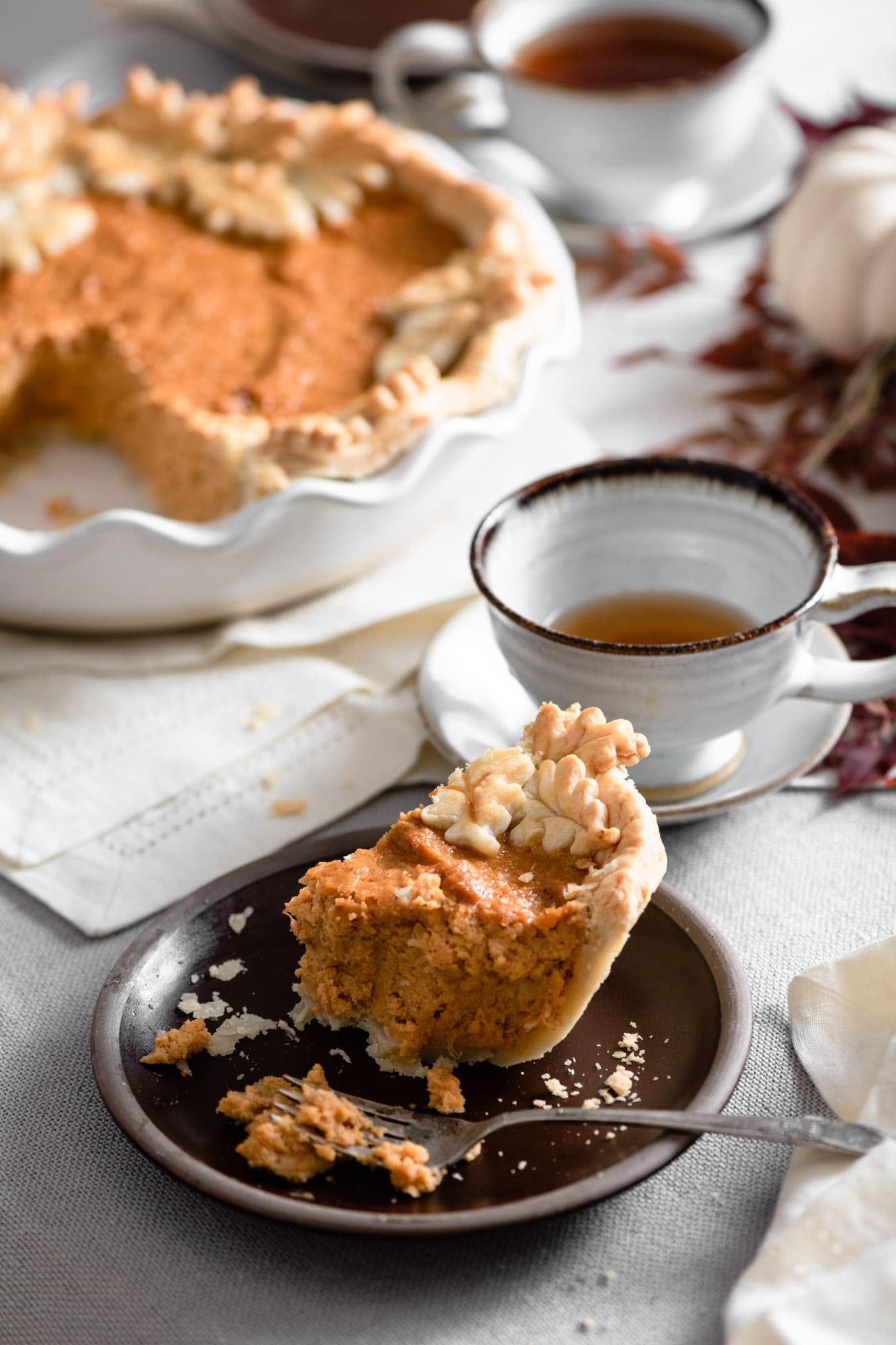 slice of sweet potato pie with tea