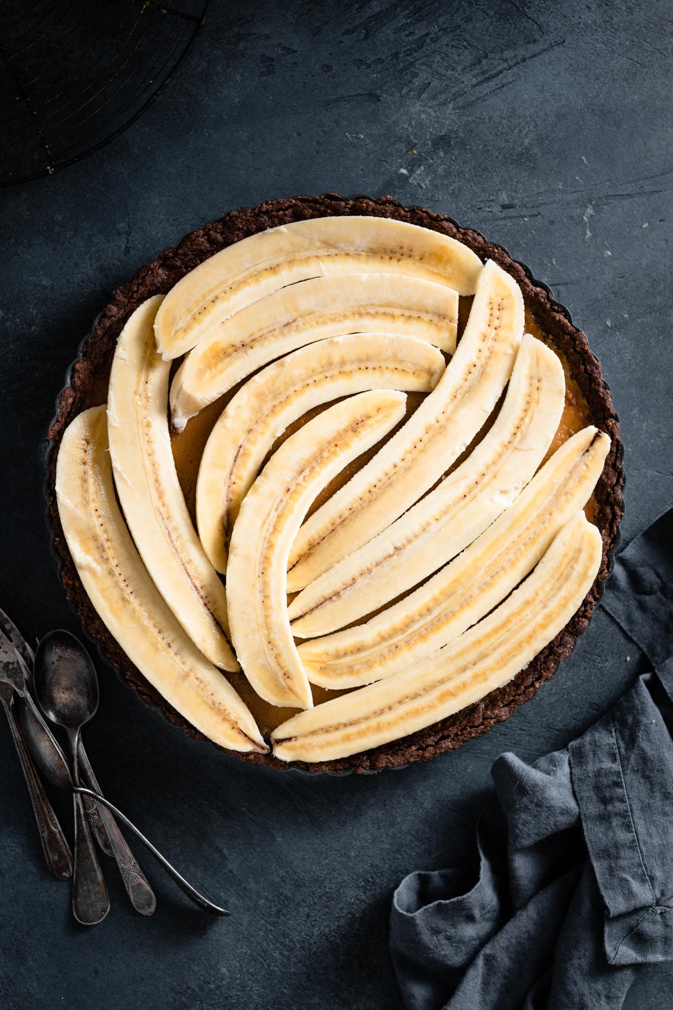 Banana tart with a chocolate coconut crust.