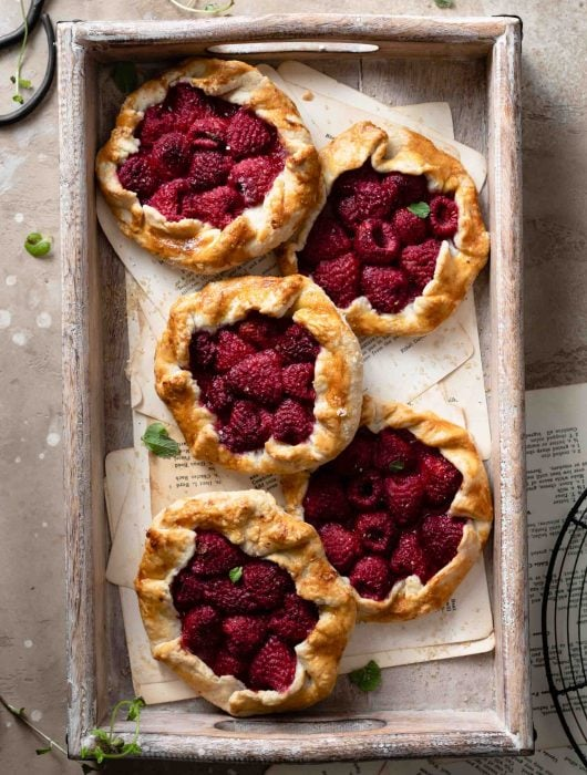 Rustic Raspberry Tarts made with short crust pastry.