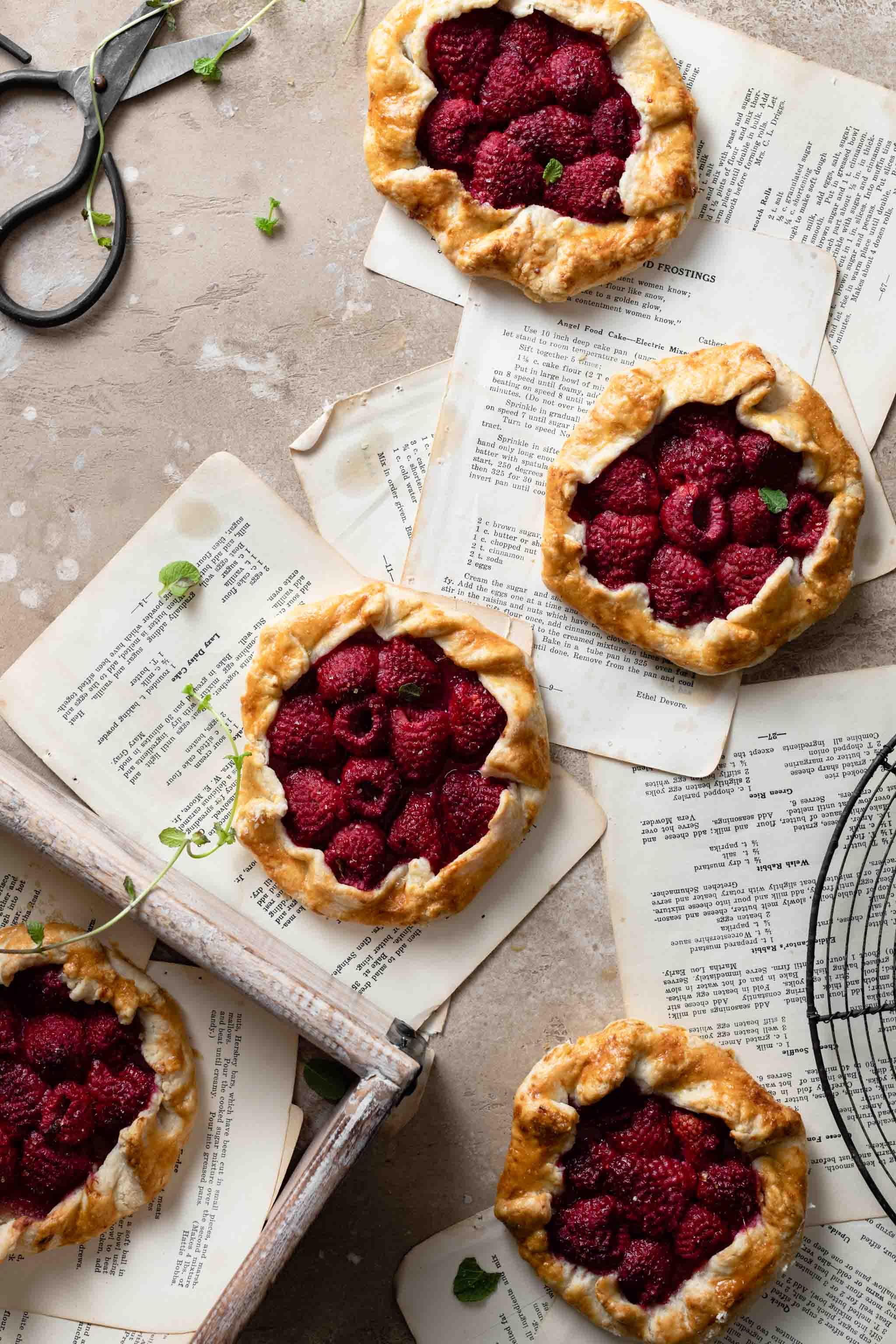 Homemade Raspberry Tarts with mint and orange juice.