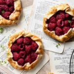 Raspberry Pies made with short crust pastry and mint.