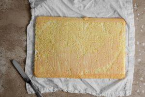 Rolling a swiss roll cake sponge.