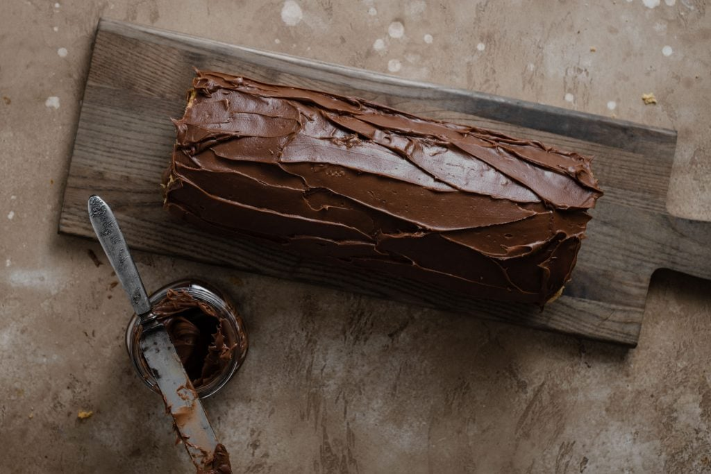 chocolate frosting on a swiss roll.
