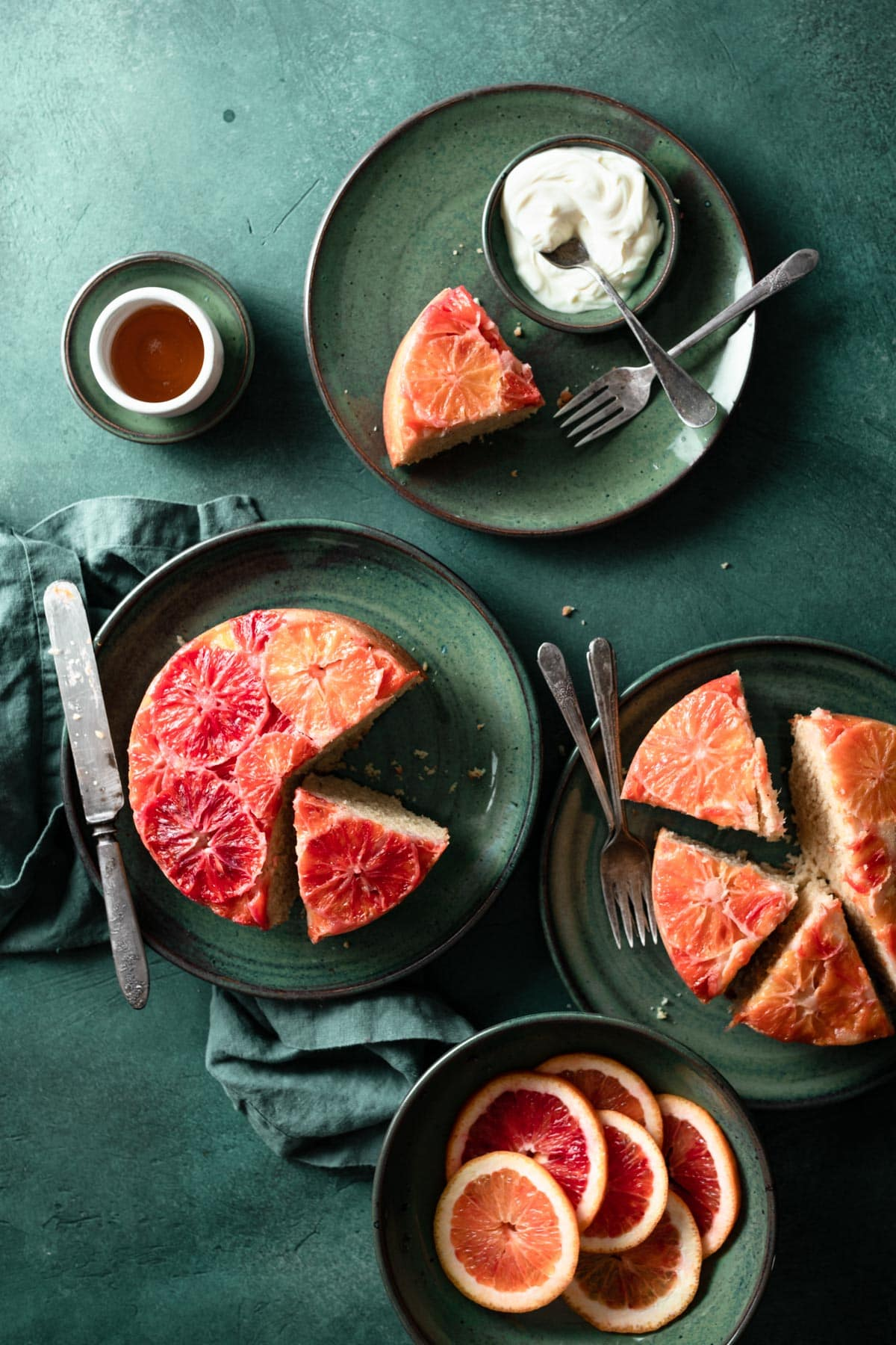 Upside down blood orange cakes with whipped cream.