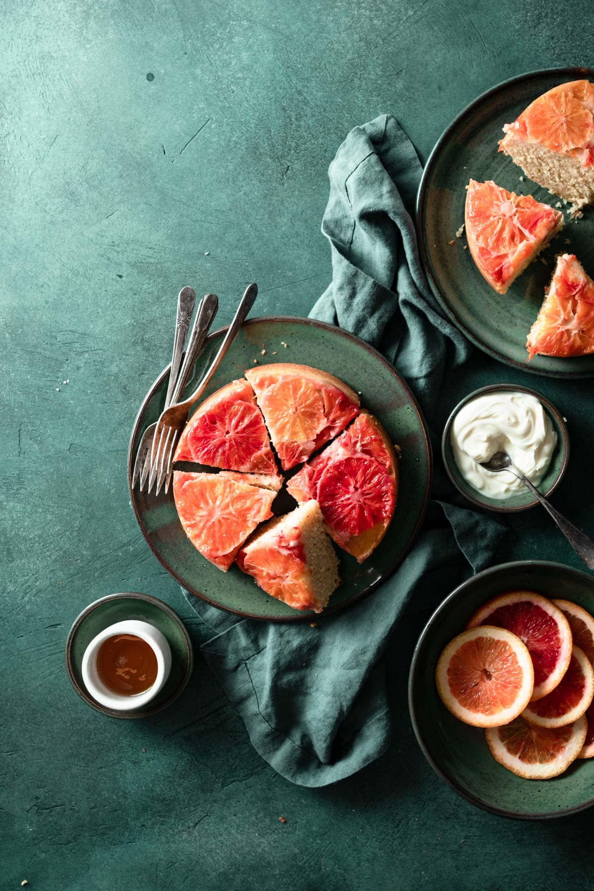 Blood orange upside down cakes with whipped cream and honey.