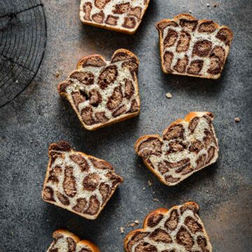 Slices of leopard bread on table.