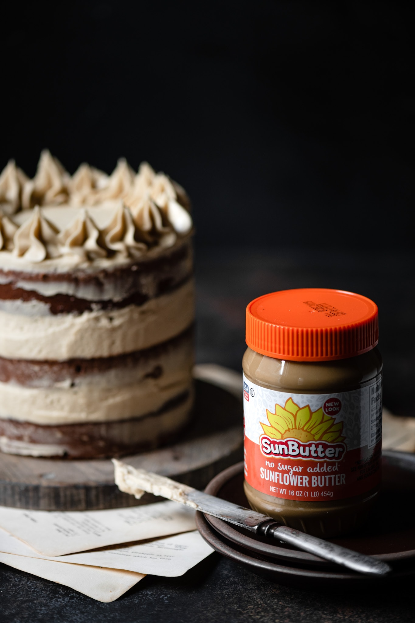 Chocolate Sunflower cake with jar of SunButter.